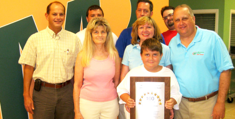Minuteman Press franchise owner Steve Brunk (right) along with family and the team in Vero Beach, Florida. http://www.minutemanpressfranchise.com
