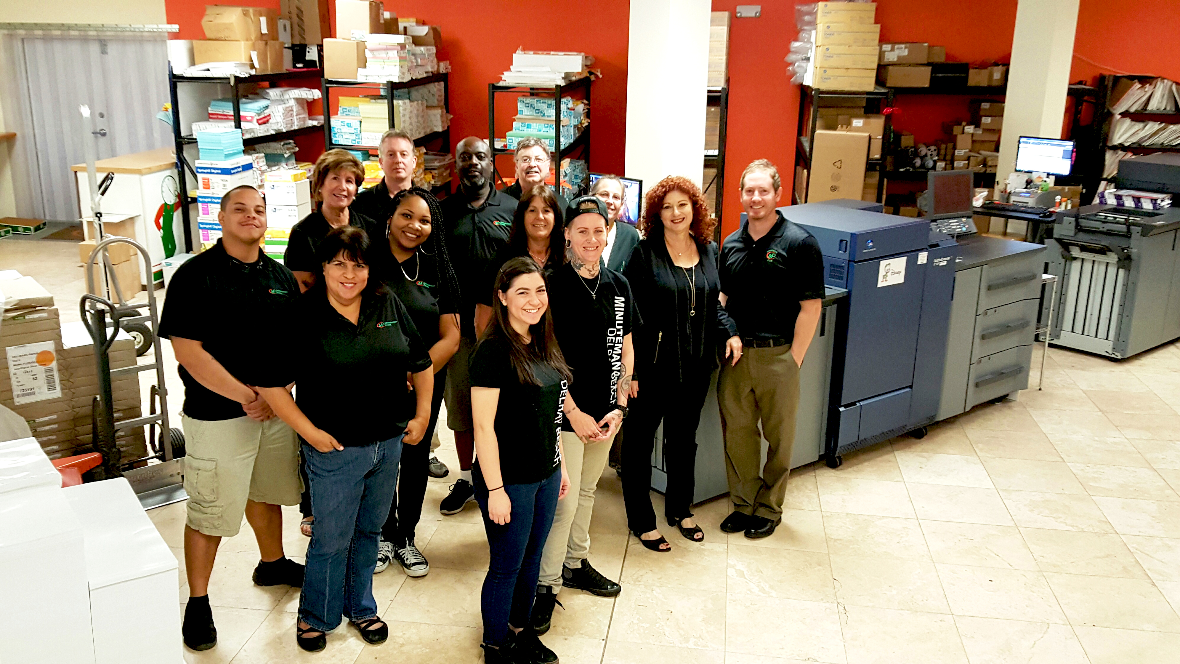 The Minuteman Press franchise staff in Delray Beach love their two Konica Minolta bizhub PRESS® 1100s. Pictured from left to right are: Josh, Idie, Julie, Shennel, Angelo, Melissa, Reggie, Carmen, James, Ricky, Linda, Gail, and owner Matthew Perry. http://www.minutemanpressfranchise.com