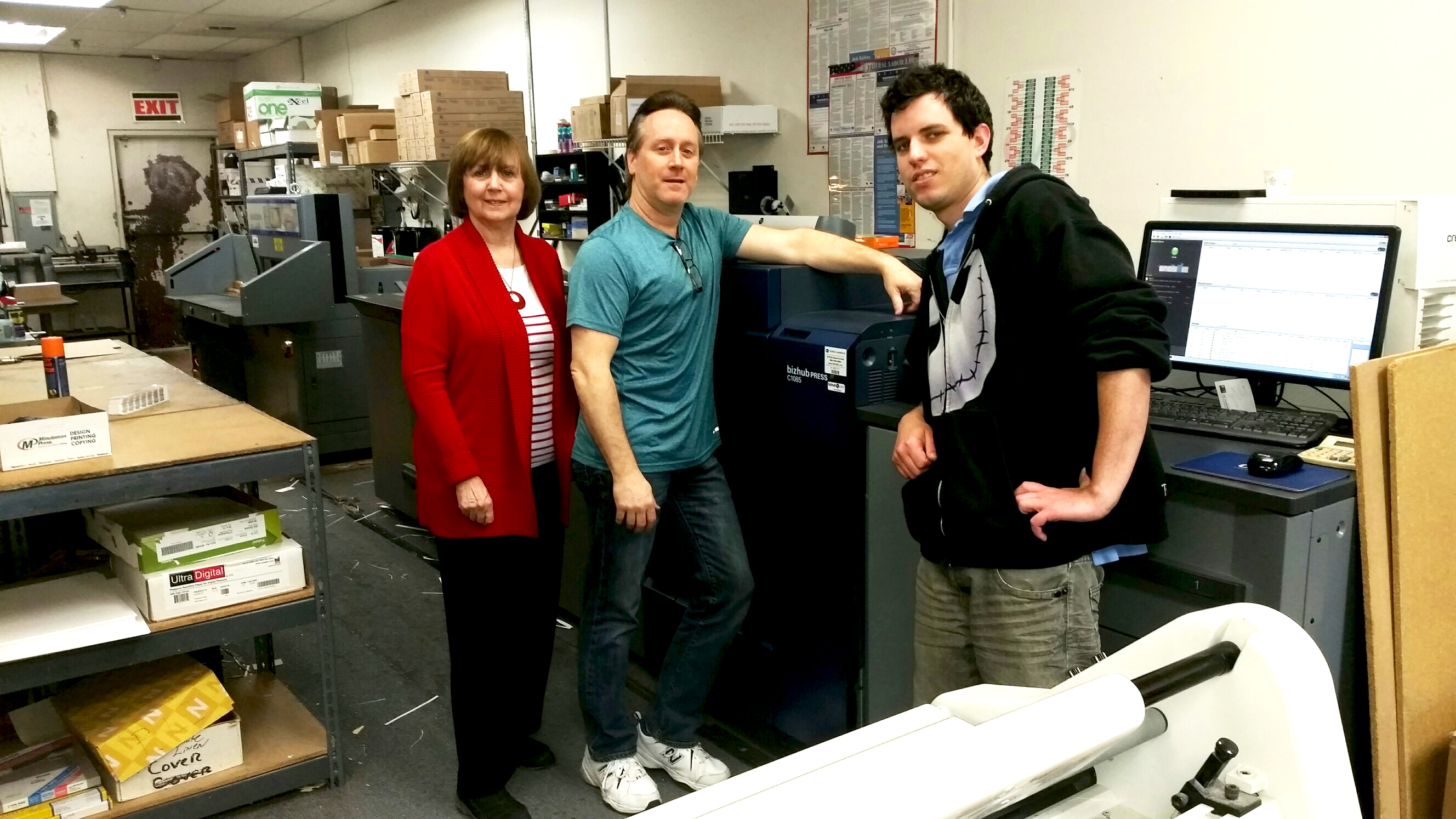 The Minuteman Press franchise in Selden, Long Island, NY appreciates the speed and efficency of their Konica Minolta C1085 digital press. Pictured from left to right are: Rita Passeggio – Owner, Scott Bomine – Shop Manager, and Miles Mongeau – Graphic Designer http://www.minutemanpressfranchise.com