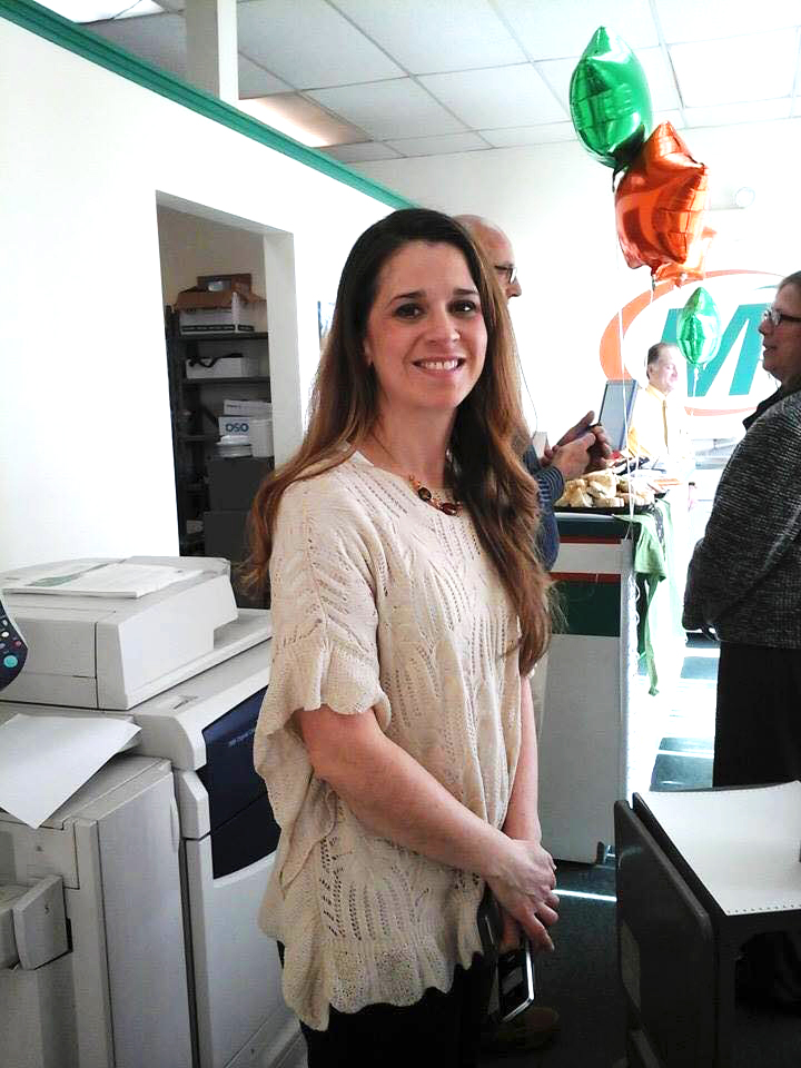 Kimberly Sherman-Leon inside her Minuteman Press printing franchise in Johnston, RI during her grand re-opening event. http://www.minutemanpressfranchise.com