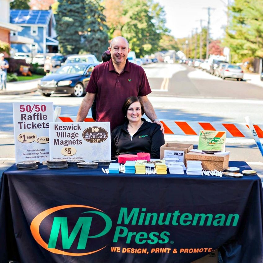 Charlie and Lyn Church say hello to neighbors and market their business at the Keswick Village Festival. http://www.minutemanpressfranchise.com