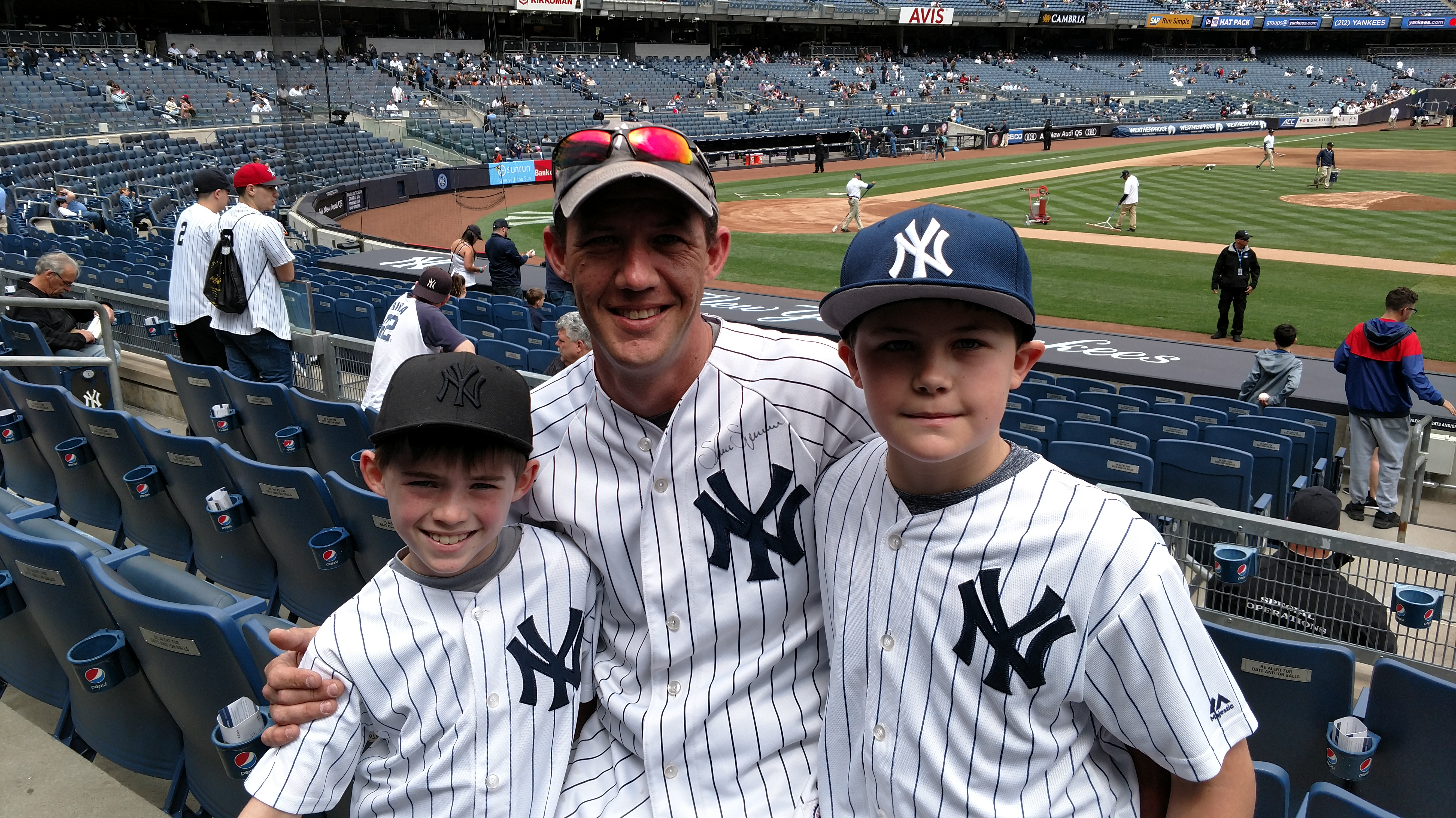 Jason Jacobus with his sons Cole (left) and Jared (right) at a recent New York Yankees game at Yankee Stadium, Bronx, NY. http://www.minutemanpressfranchise.com