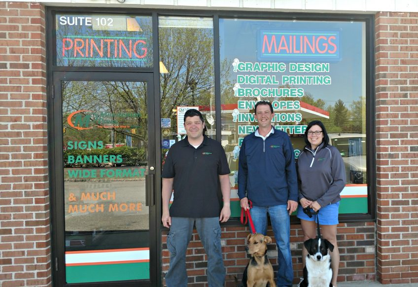 Minuteman Press, Flemington, NJ - left to right: Steve Fucito (creative director), Jason Jacobus (owner), and Jennifer Brigham (CSR). In front are Sasha and Xerox, who are affectionately known as VPs of Customer Relations. http://www.minutemanpressfranchise.com