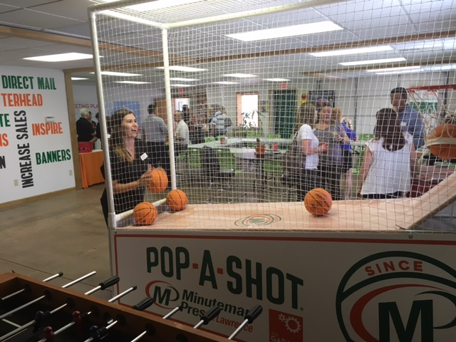 The current high score for the Minuteman Press franchise Pop-A-Shot basketball game is 77 points. http://www.minutemanpressfranchise.com