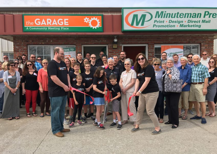 Dee Bisel and her team celebrate their new Minuteman Press franchise location at 1404 E. 24th Street, Suite B, with a ribbon-cutting ceremony in Lawrence, KS. http://www.minutemanpressfranchise.com