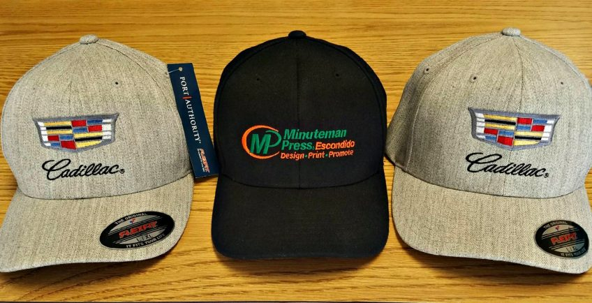 Minuteman Press custom branded apparel - promotional hats for Cadillac and Minuteman Press in Escondido, CA http://www.minutemanpressfranchise.com
