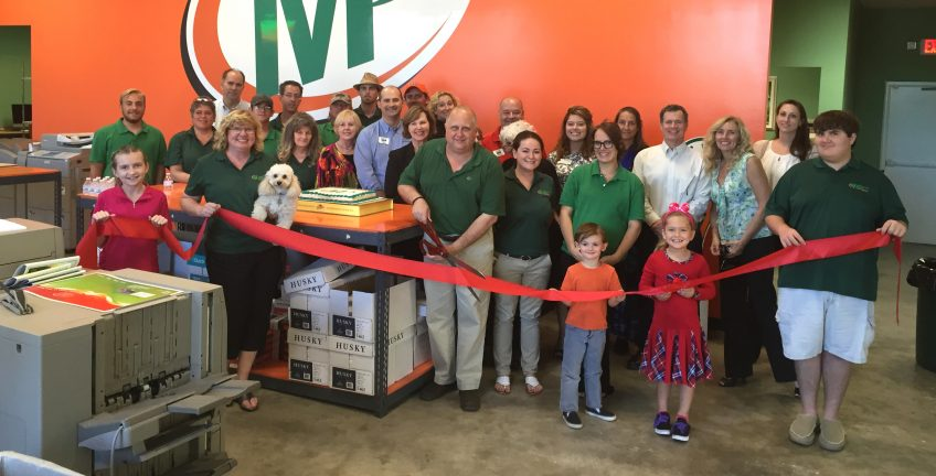 Steve Brunk (holding scissors) owns the Minuteman Press design, marketing, and printing franchise in Vero Beach, Florida. http://www.minutemanpressfranchise.com