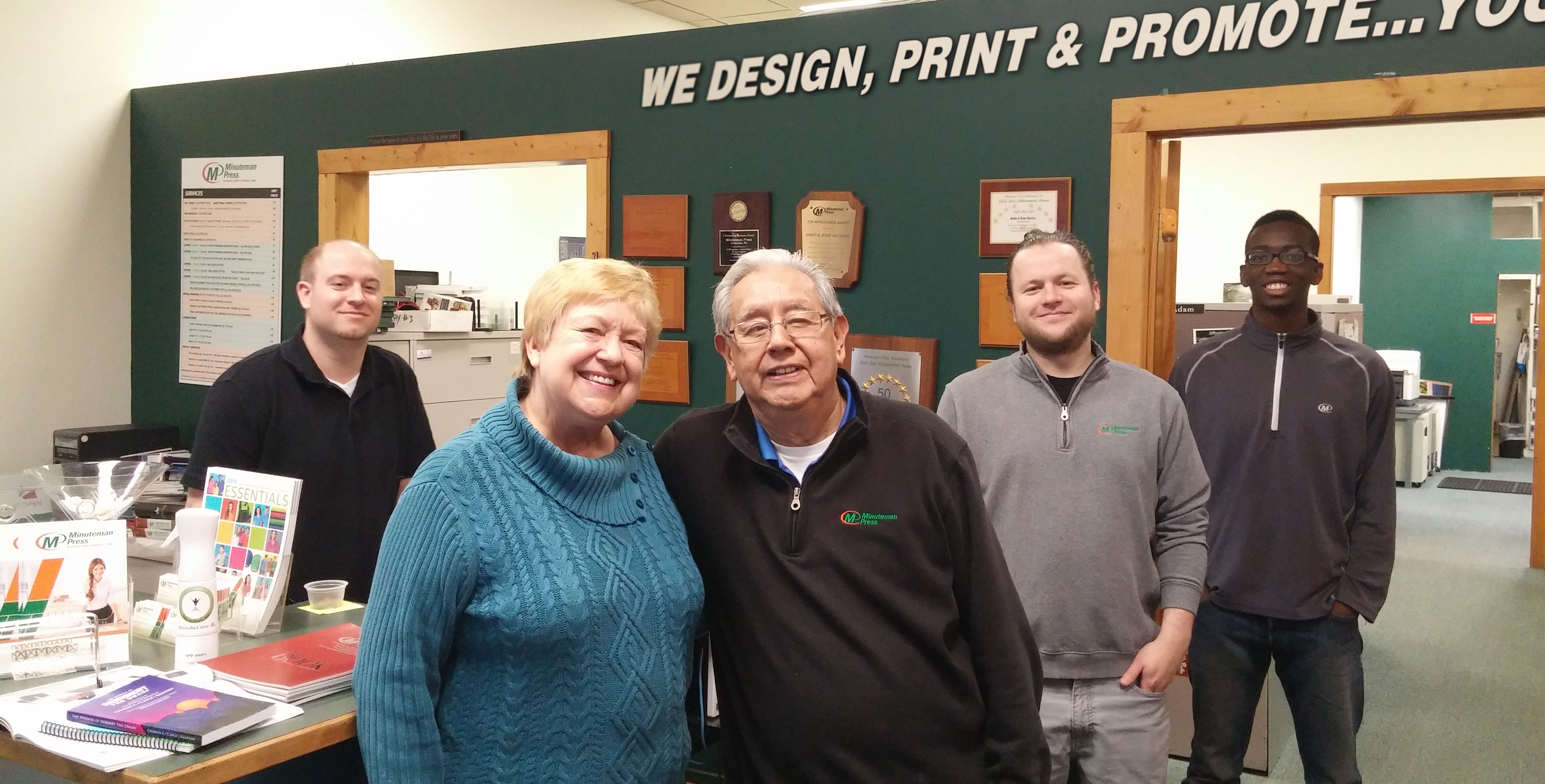 Minuteman Press printing franchise, Kenosha, Wisconsin - Owners Sandy and Jesse Aguilera (front center) along with their team members Adam, Dan, and Cale. http://www.minutemanpressfranchise.com
