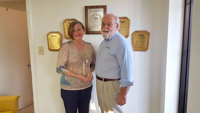 Minuteman Press printing franchise owners Betsy Davis (left) and Brian Davis (right) with their well-deserved Crystal Pinnacle Award commemorating over 25 years in business in Lexington, Kentucky. http://www.minutemanpressfranchise.com