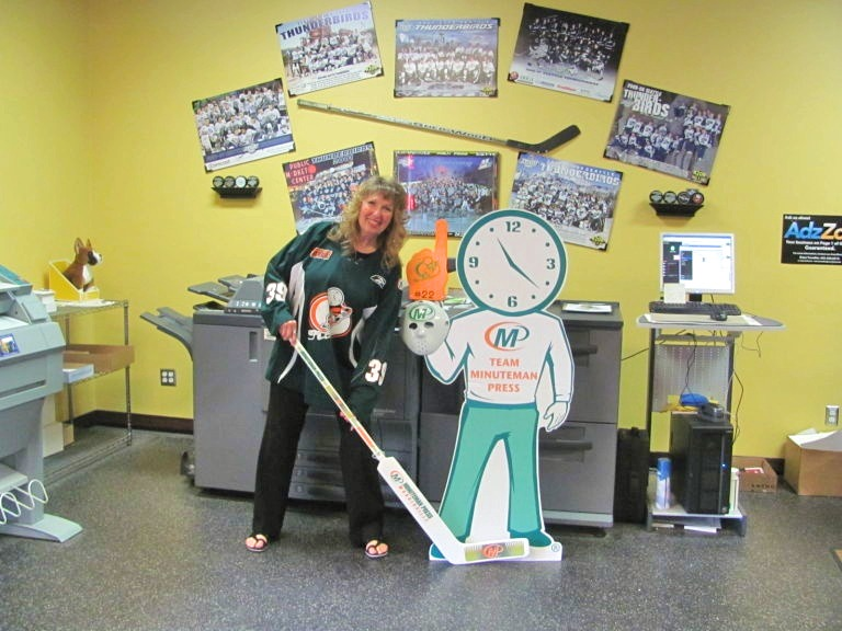 """Chris Lewis, owner of Minuteman Press in Woodinville, Washington – proudly displaying her brand as part of """"Team Minuteman Press"""" http://www.minutemanpressfranchise.com"""