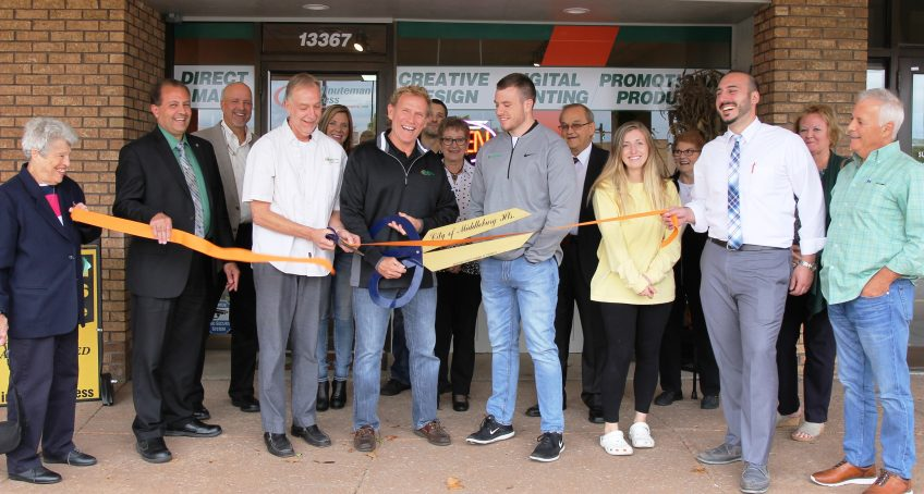 Chris Williams (center, holding scissors) celebrates the grand re-opening of his Minuteman Press franchise in Middleburg Heights, Ohio. http://www.minutemanpressfranchise.com