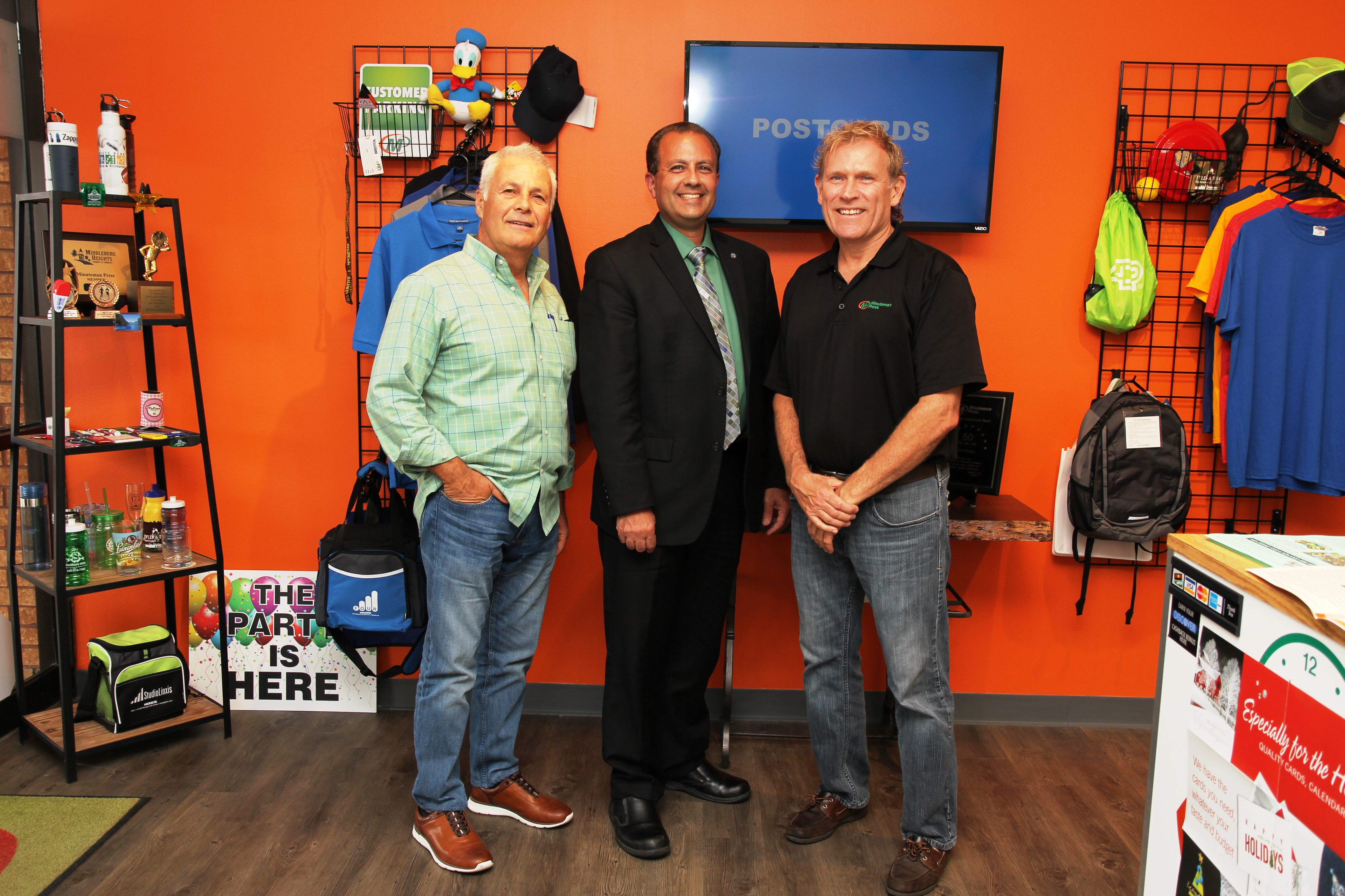 Chris Williams (right) inside his brand new Minuteman Press franchise location in Middleburg Heights, Ohio. http://www.minutemanpressfranchise.com