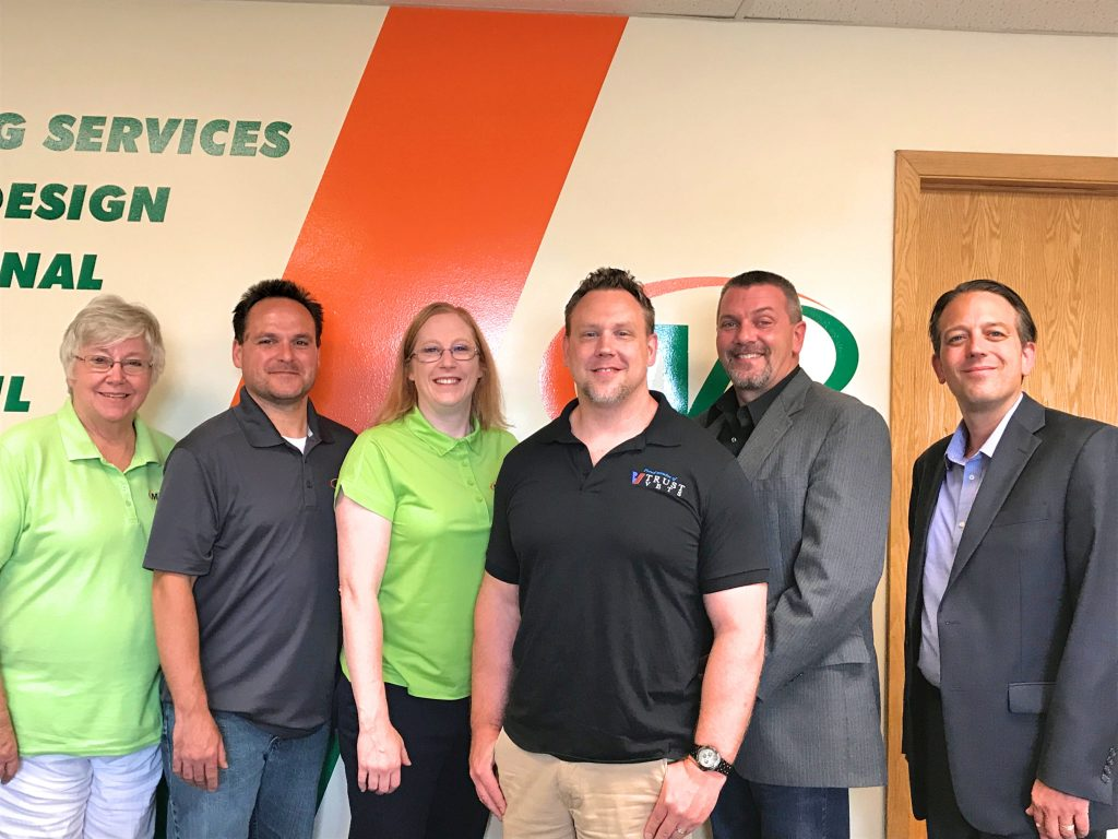 Minuteman Press, Ham Lake, MN - L-R: Susan Fitzpatrick, Office Specialist; Tim Sofie, Marketing Manager; Katie Lawrence, Owner; James Lawrence, Owner; Joe Johnson, Trust Vets Colleague; Adam Peters, Minuteman Press International Field Representative. http://www.minutemanpressfranchise.com