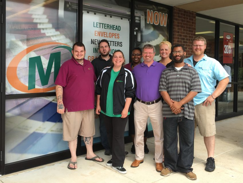 Minuteman Press printing franchise - Huntsville, Alabama - Jonathan Dunwoody (center) along with his dedicated team. http://www.minutemanpressfranchise.com