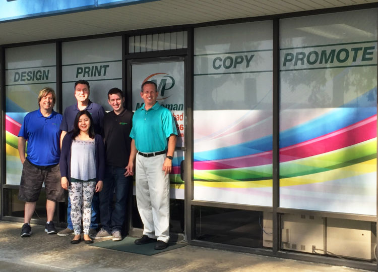 Minuteman Press printing franchise staff in Carlsbad, CA - pictured from left to right: Graphic Design Manager Ron Jones, Production Manager Bill Hawk, Customer Service Manager Karina Revita, Production Specialist Shane Sirota, and Franchise Owner Jeff Sirota http://www.minutemanpressfranchise.com