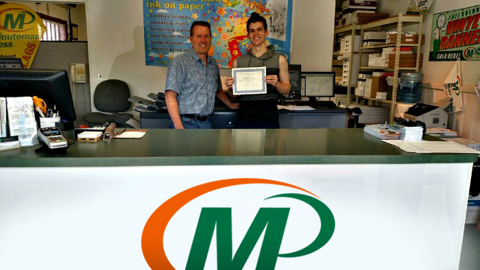 Minuteman Press franchise owner Dave Loudon presents home-schooled high school graduate Dan with his freshly printed diploma in East Northport, Long Island, NY. http://www.minutemanpressfranchise.com