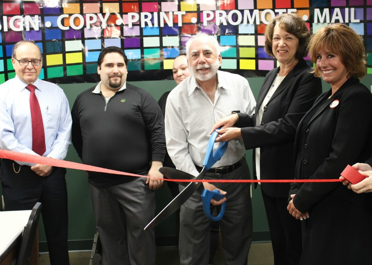 Gail and Steve Weber (with scissors) cutting the ribbon for their new Minuteman Press facility in New London, CT. http://www.minutemanpressfranchise.com
