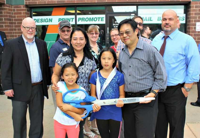 Lotus Juo, James Juo and their daughters Janissa and Jianna take center stage at the Minuteman Press franchise grand opening in Westminster, Colorado. http://www.minutemanpressfranchise.com