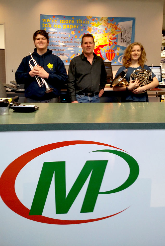Minuteman Press franchise owner David Loudon (middle) with teen musicians Dan (left) and Pegeen (right). http://www.minutemanpressfranchise.com